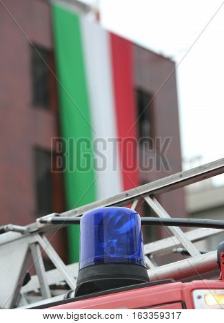 Fire Truck And The Huge Italian Flag On The Background