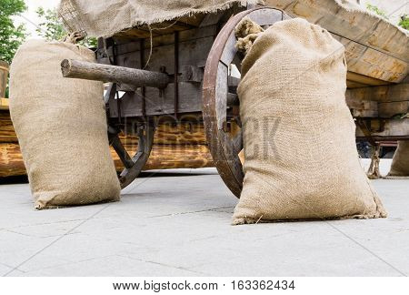 Burlap Sacks Near Cart