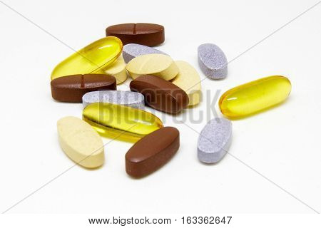 Closeup to Multivitamin tablets on white background.