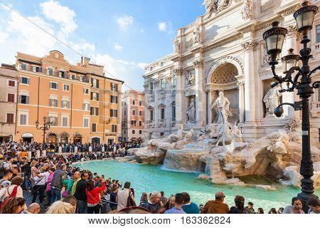 Tourist Near Trevi Fountain In Rome City