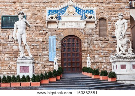 FLORENCE ITALY - NOVEMBER 4 2016: doors of museum in Palazzo Vecchio with statues David (copy) and Hercules and Cacus. Original David is Renaissance sculpture created in 1501 - 1504 by Michelangelo
