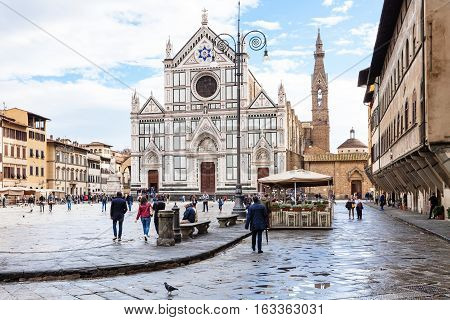 Tourists On Piazza Di Santa Croce With Basilica