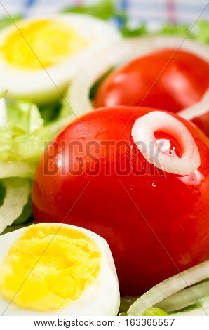 Cherry Tomatoes And Boiled Eggs In A Salad With Lettuce Leaves