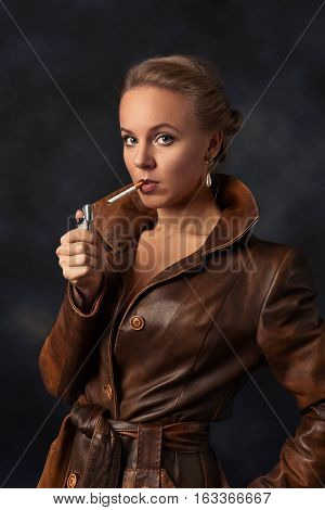 Beautiful Woman In Brown Leather Coat With Lighter And Cigarette