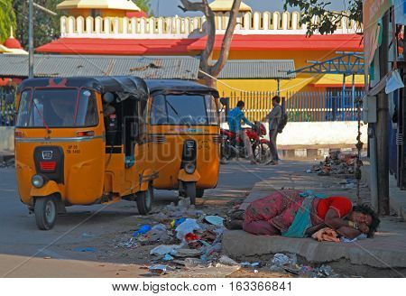 Hyderabad India - March 11 2015: homeless woman is sleeping outdoor in Hyderabad India