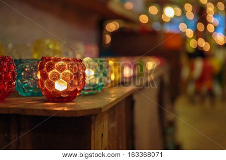 Colorful scented candles in cute glass with beautiful lighting and bokeh.