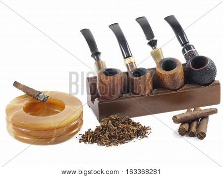 Italian tobacco products. Toscano half cigars, pipe cut tobacco and wooden pipes.