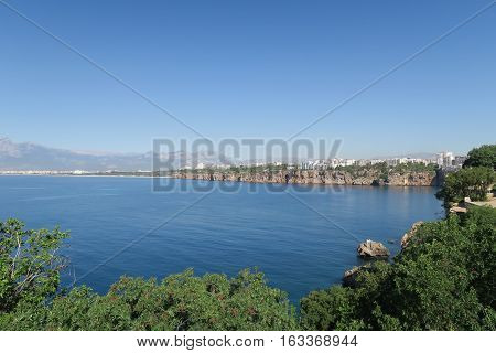 The Mediterranian Sea, the Cliffs of Antalya, Konyaalti Beach and the Taurus Mountains in the Background