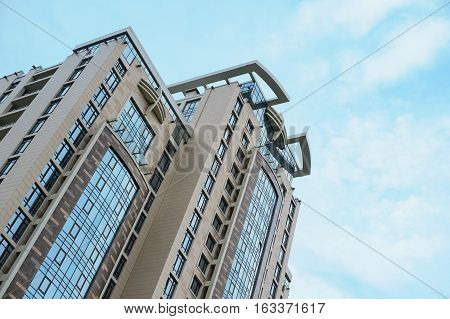 Multistorey apartment house on the sky background.