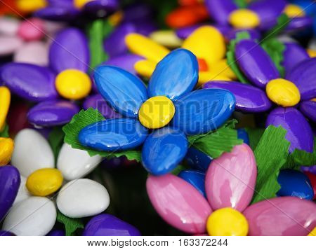 Colored sugared almonds as petals for these floral creations.