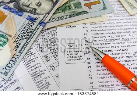 Tax form individual tax return with pen