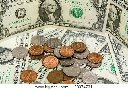 one American Dollar bills with us coins