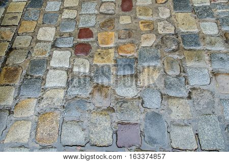 Pavement texture. Background of old cobblestone pavement close-up.