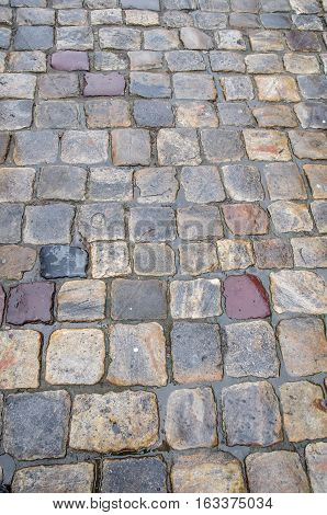 old cobbles after rain for design as background