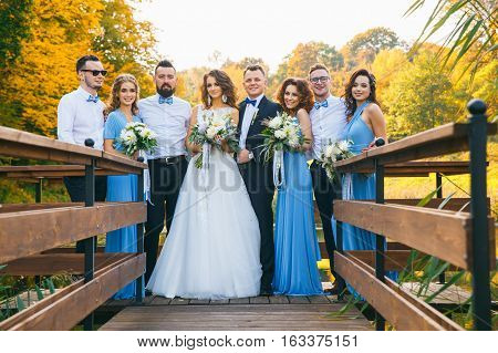 Newly Married Couple With Groomsmen And Bridesmaids