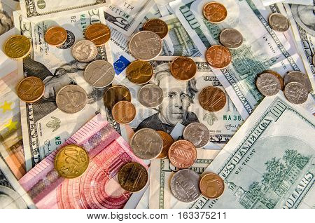 US Dollar and Euro with coins as background