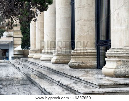 Detail of a court house. Roman columns architecture in Valletta, Malta
