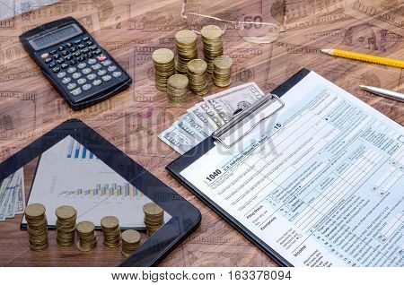 1040 tax form with tablet money pen on table