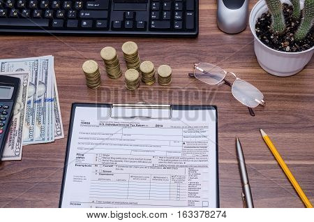 1040A tax form with money calculator pen
