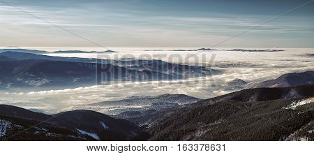 Mountain panorama - inversion and colorful sky in Low Tatras Slovakia