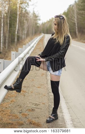 Beautiful Young Girl Corrects Stockings.