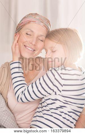 Child Hugging Ill Mother