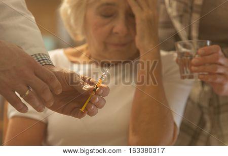 Senior Woman, Doctor Holding Syringe