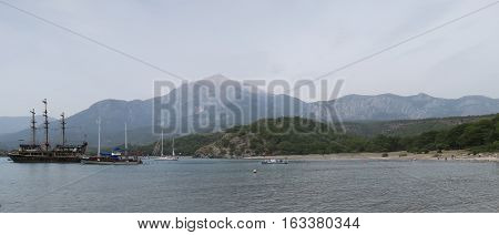 Tahtali Dagi - Olympos - Mountain and Sailing Ships, as seen from the Coast in Tekirova, Kemer