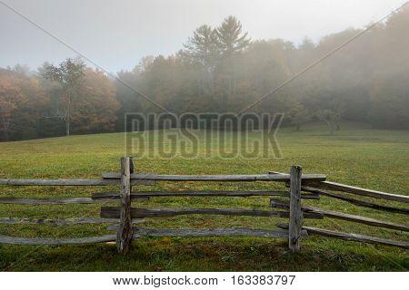 Split Rail Fence On Edge Of Foggy Field
