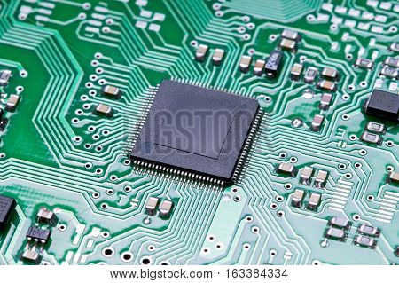 Close up microchip of a printed circuit board