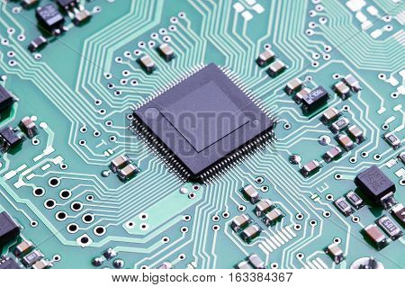 Close up printed circuit board of an electronic device with microelements