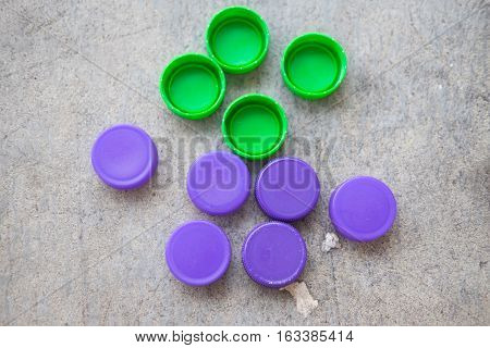 Green and violet plastic bottle screw caps top view