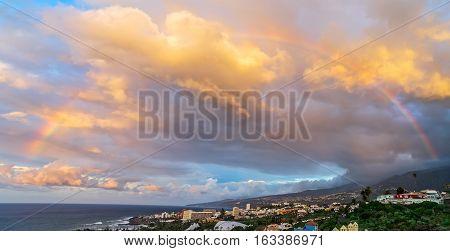 Rainbow in sky, tropical sunset on Tenerife, Canarias Spain