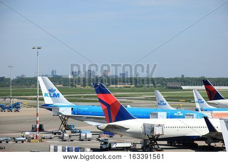 Amsterdam The Netherlands - May 13th 2016: planes from Delta Airlines and KLM parked on Amsterdam Schiphol Aiport