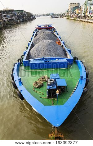 My Tho, Vietnam - February 13: Boat With Stones Floating On Mekong On February 13, 2012 In My Tho, V
