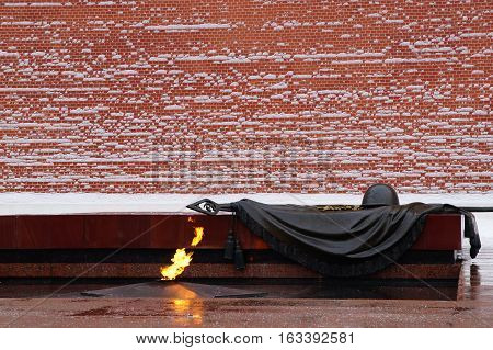 The eternal flame constantly burning fire, the walls of the Moscow Kremlin.