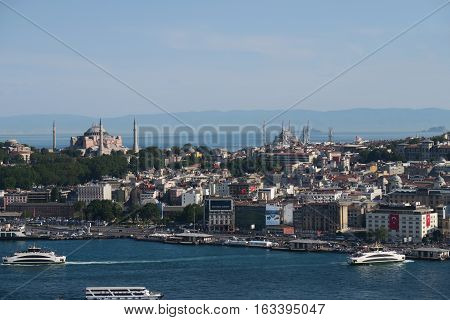 Topkapi Palace, Hagia Sophia and the Blue Mosque, as seen from Galata - Beyoglu - with the Marmara Sea in the Background and the Golden Horn - Bosphorus in the foreground in Istanbul, Turkey.