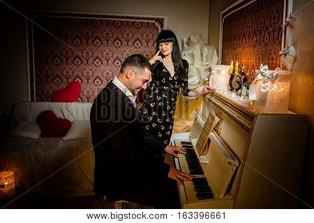 Man playing piano for his girlfriend. Day of valenitina