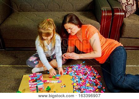 Mother And Child Daughter Playing Together, Build From The Constructor. Cute Her Son Play