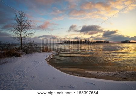 Winter landscape with sunset sky and river. Daybreak