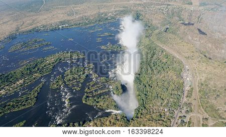 The Zambezi River from the air, the break-off edge and the spray of Victoria Falls, landscape in Zambia and Zimbabwe
