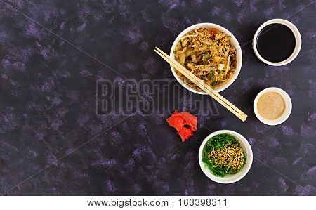 Udon Noodles With Seafood On Dark Background. Top View.