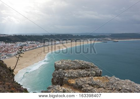 The coast of Atlantic ocean in Nazare one of the most popular seaside resorts in the Silver Coast Portugal