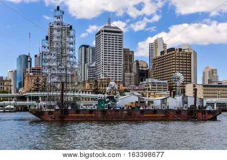 BRISBANE, AUSTRALIA - SEPTEMBER 9, 2012: Boat passing in front of the Central Business District in Brisbane Australia