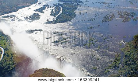View from the air to the Victoria Falls,  Zambezi River with wooded islands