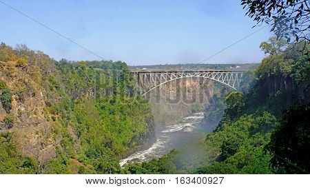 Above the deep gorge of the Zambezi is the border bridge between Zambia and Zimbabwe