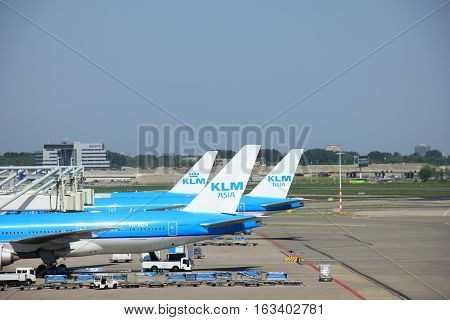 Amserdam The Netherlands - May 13th 2016: KLM Boeings 777 lined up at gates at Amserdam Schiphol Airport
