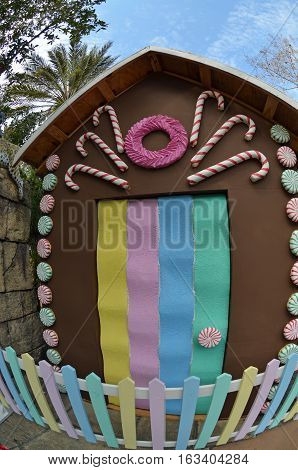 Life size gingerbread house with candy cane and gum drop decorations