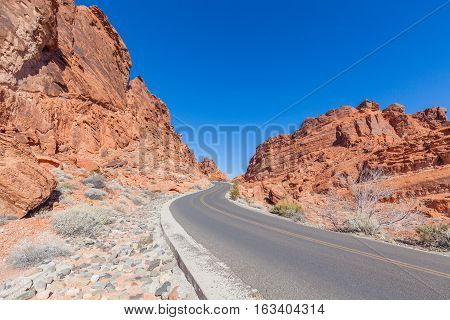 road passing through scenic valley of fire state park near Las Vegas Nevada