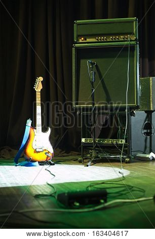 Electric guitar and amplifier rack on a concert stage